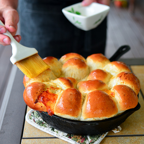 Cheesy Cast Iron Yeast Rolls